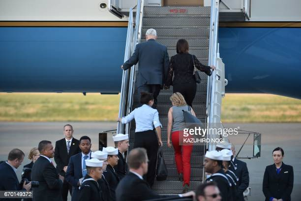 US Vice President Mike Pence his wife Karen and their two daughters Audrey and Charlotte walk up to their aircraft as they depart Japan from the US...