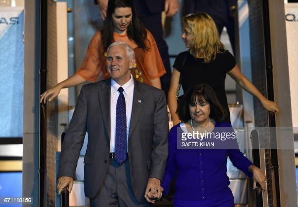 US Vice President Mike Pence his wife Karen and their two daughters Audrey and Charlotte exit the plane as they arrive at Sydney airport on April 21...