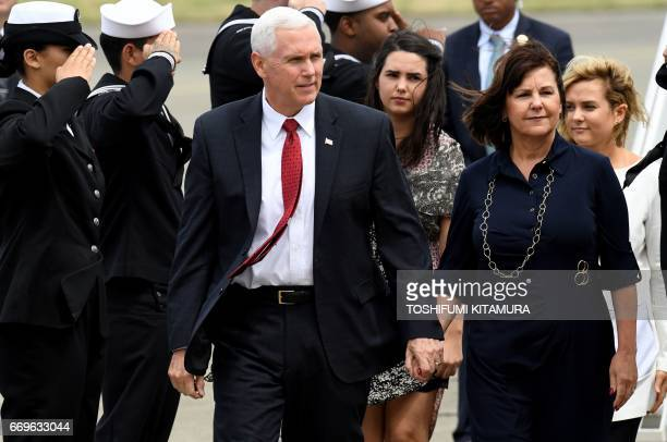 US Vice President Mike Pence his wife Karen and two daughters Audrey and Charlotte walk after arriving at the US naval air facility in Atsugi...