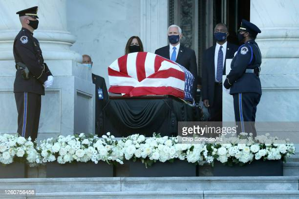 S Vice President Mike Pence his wife Karen Pence and Housing and Urban Development Secretary Ben Carson pay their respects to Rep John Lewis as his...