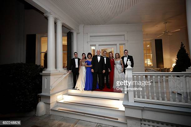 S Vice President Mike Pence his wife Karen Pence their daughters Audrey and Charlotte and their son Michael and his wife Sarah pose for photographs...