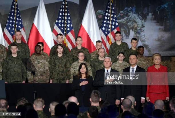 Vice President Mike Pence , his wife Karen , Polish President Andrzej Duda and Polish First Lady Agata Kornhauser-Duda listen to the U.S. National...