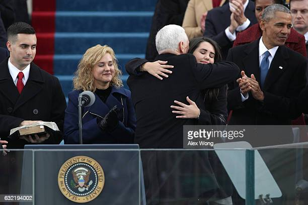 Vice President Mike Pence hugs his daughter Audrey Pence on the West Front of the US Capitol on January 20 2017 in Washington DC In today's...
