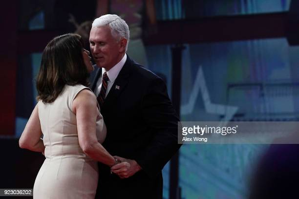 S Vice President Mike Pence is greeted by his wife and second lady Karen Pence on stage during CPAC 2018 February 22 2018 in National Harbor Maryland...