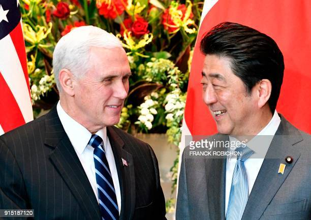 US Vice President Mike Pence is welcomed by Japan's Prime Minister Shinzo Abe upon his arrival at the prime minister's official residence in Tokyo on...