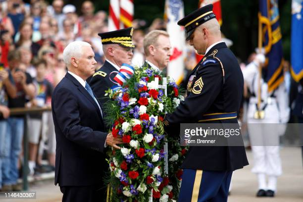 S Vice President Mike Pence lays a wreath at the Tomb of the Unknown Soldier at Arlington National Cemetery on May 27 2019 in Arlington Virginia