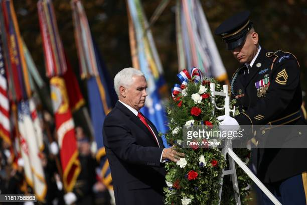 S Vice President Mike Pence lays a wreath at the Tomb of the Unknown Soldier at Arlington National Cemetery on November 11 2019 in Arlington Virginia...