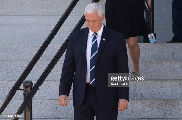 Vice President Mike Pence leaves the Eisenhower Executive Office Building adjacent to the White House in Washington, DC, November 9, 2020. - Joe...