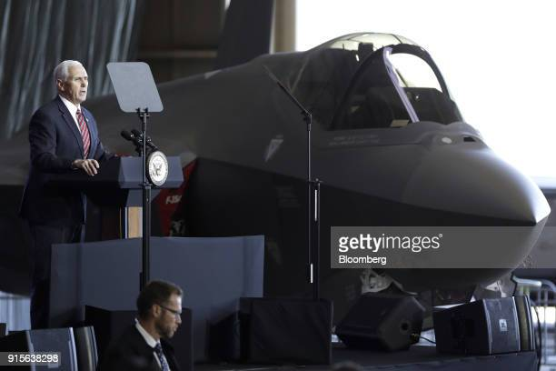 US Vice President Mike Pence left addresses US military personnel next to a US Air Force F35 fighter jet at US Yokota Air Base in Fussa Tokyo...