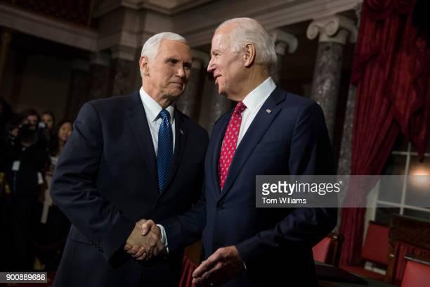 Vice President Mike Pence left and former VP Joe Biden attend a swearingin ceremony for Sen Doug Jones DAla and Sen Tina Smith DMinn in the Capitol's...