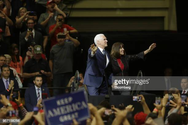 US Vice President Mike Pence left and his wife Second Lady Karen Pence arrive at a rally in Elkhart Indiana US on Thursday May 10 2018...