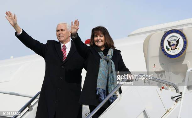 US Vice President Mike Pence left and Second Lady Karen Pence wave as they board Air Force Two departing at US Yokota Air Base in Fussa Tokyo...