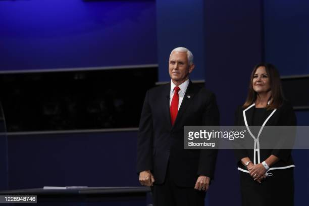 Vice President Mike Pence, left, and U.S. Second Lady Karen Pence stand on stage during the U.S. Vice presidential debate at the University of Utah...