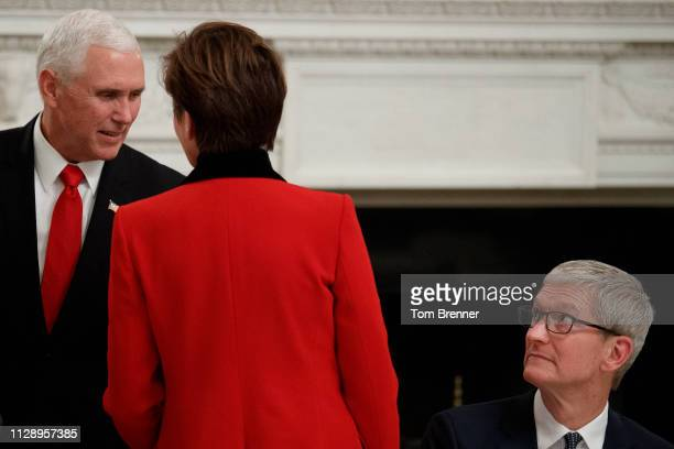 Vice President Mike Pence left greets Iowa Governor Kim Reynolds as Apple CEO Tim Cook looks on during a meeting with the American Workforce Policy...
