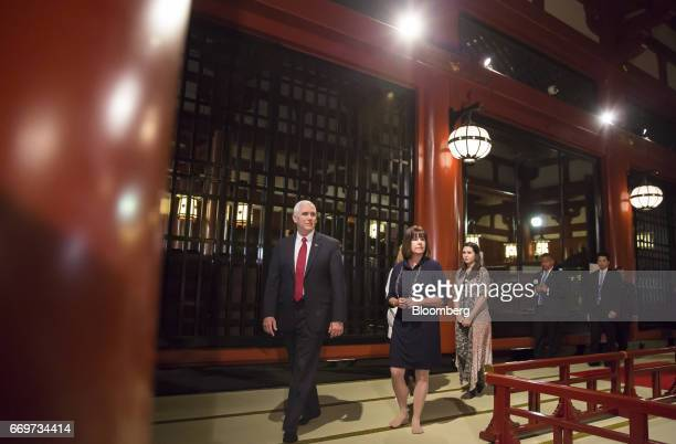 US Vice President Mike Pence left second lady Karen Pence center left and one of their daughters Audrey walk through the Sensoji temple in Tokyo...