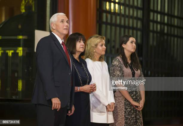US Vice President Mike Pence left second lady Karen Pence center left and their daughters Charlotte center right and Audrey visit the Sensoji temple...