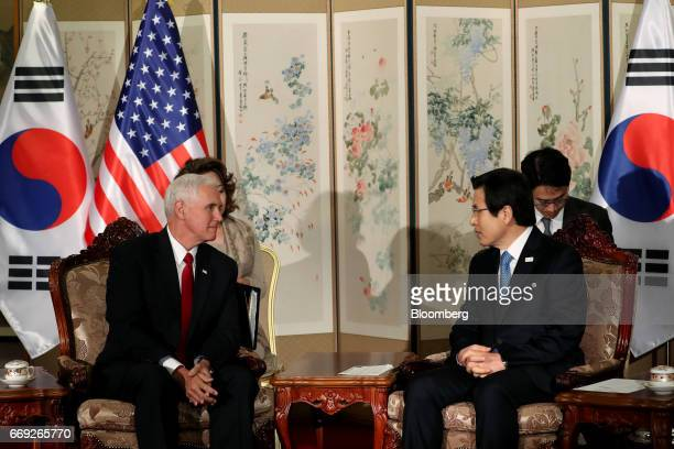 US Vice President Mike Pence left sits with Hwang Kyoahn South Korea's acting president and prime minister ahead of a meeting in Seoul on Monday...