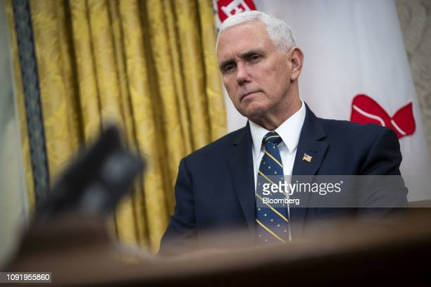 US Vice President Mike Pence listens during a meeting on trade talks between the US and China in the Oval Office of the White House in Washington DC...