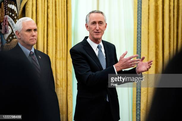 Vice President Mike Pence listens to Gilead Sciences Chairman and CEO Daniel O'Day during an announcement that the Food and Drug Administration...