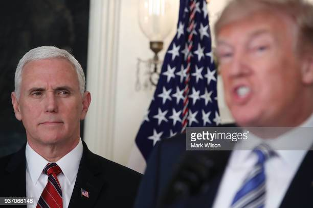S Vice President Mike Pence listens to President Donald Trump speak to the press about the $13 trillion spending bill passed by Congress early Friday...