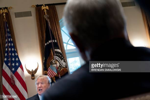 US Vice President Mike Pence listens to US President Donald Trump during a meeting about border security in the Cabinet Room of the White House...