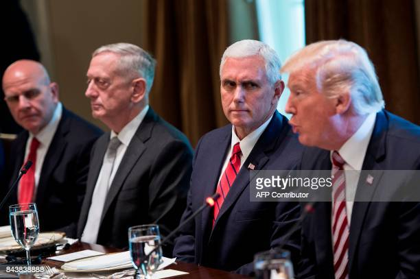 US Vice President Mike Pence listens with National Security Advisor H R McMaster and US Secretary of Defense James Mattis as US President Donald...