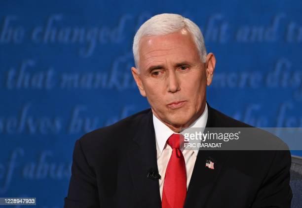 Vice President Mike Pence looks on during the vice presidential debate in Kingsbury Hall at the University of Utah on October 7 in Salt Lake City,...