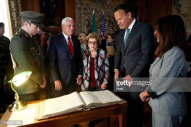 Vice President Mike Pence Mrs Nancy PenceFritsch Leo Varadkar An Taoiseach and Second Lady Karen Pence are shown the service records of Pence's...