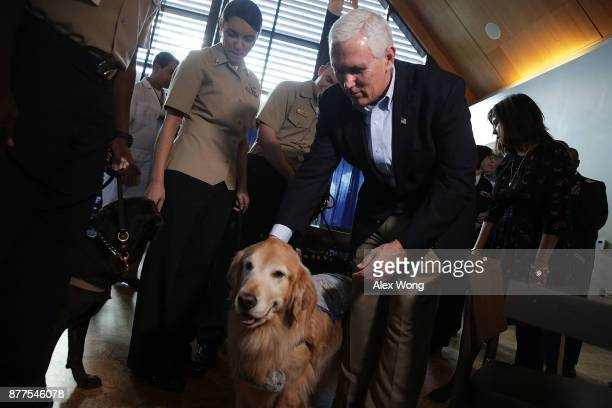 S Vice President Mike Pence pats a facility dog at the USO Warrior and Family Center November 22 2017 in Bethesda Maryland Pence and his wife placed...