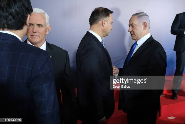 S Vice President Mike Pence Polish President Andrzej Duda and Israeli Prime Minister Benjamin Netanyahu chat following a group photo prior to the...
