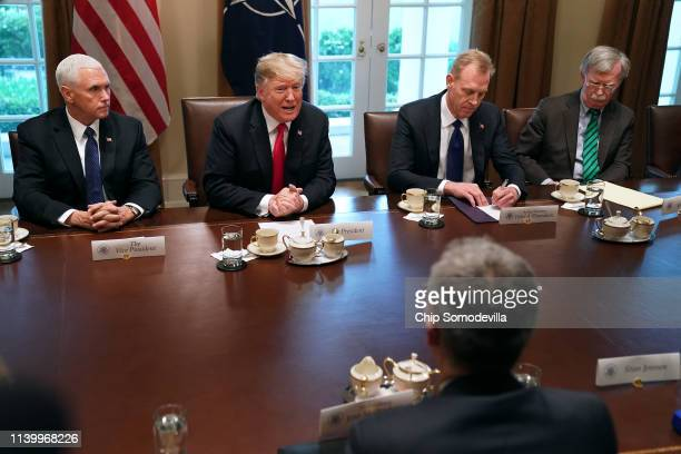 Vice President Mike Pence, President Donald Trump, Acting Defense Secretary Patrick Shanahan and National Security Advisor John Bolton sit across...