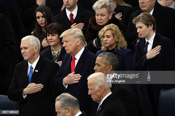 Vice President Mike Pence President Donald Trump former Vice President Joe Biden former President Barack Obama and Barron Trump listen to the...