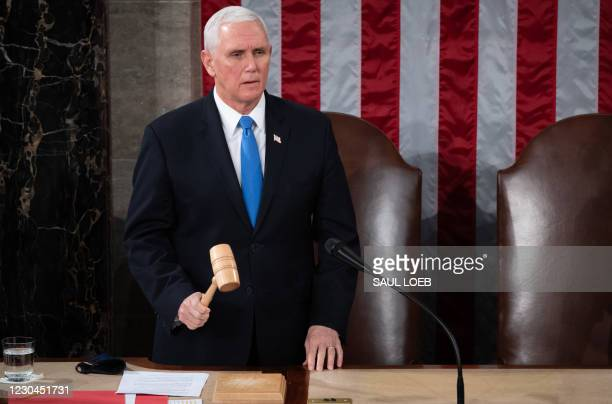 Vice President Mike Pence presides over a joint session of Congress to count the electoral votes for President at the US Capitol in Washington, DC,...