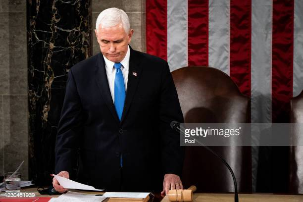Vice President Mike Pence presides over a joint session of Congress to certify the 2020 Electoral College results on January 6, 2021 in Washington,...