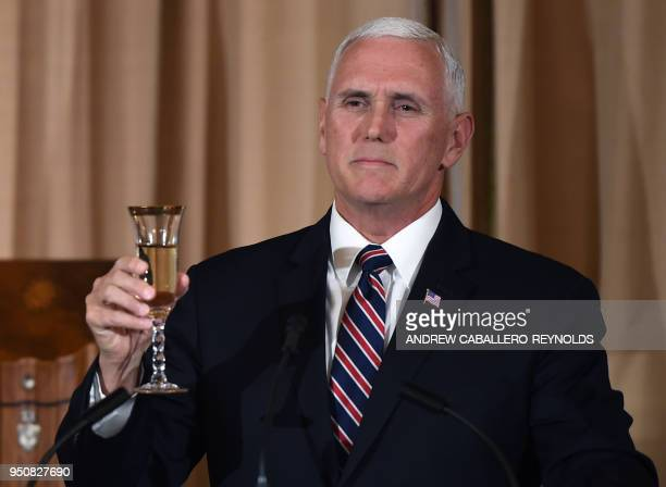 US Vice President Mike Pence raises his glass during a luncheon at the US State Department in Washington DC on April 24 2018