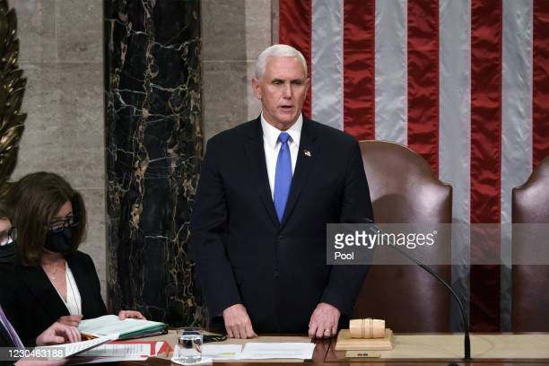 Vice President Mike Pence reads the final certification of Electoral College votes cast in November's presidential election during a joint session of...