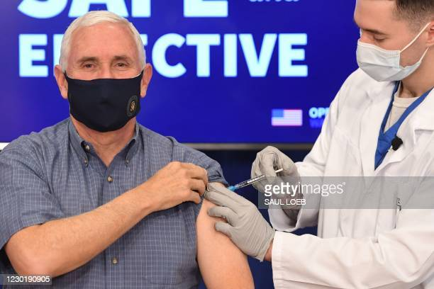 Vice President Mike Pence receives the COVID-19 vaccine in the Eisenhower Executive Office Building in Washington, DC, December 18, 2020.