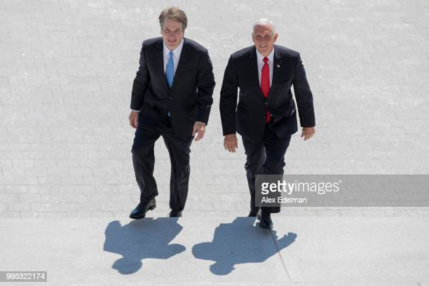 S Vice President Mike Pence right and Supreme Court nominee Brett Kavanaugh arrive at the US Capitol on July 10 2018 in Washington DC US President...