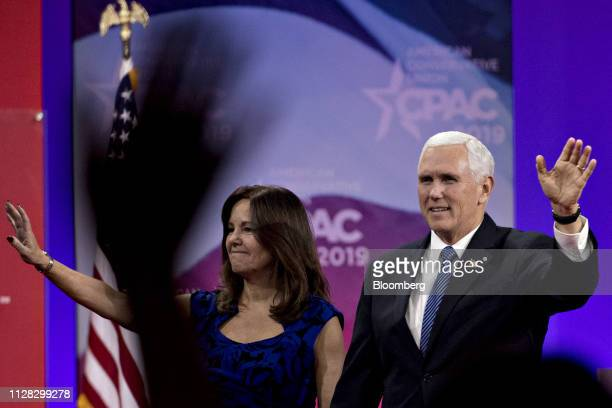 US Vice President Mike Pence right and US Second Lady Karen Pence wave while arriving to speak during the Conservative Political Action Conference in...