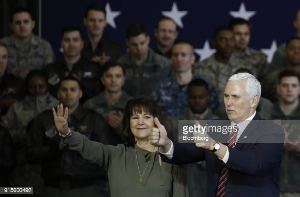 US Vice President Mike Pence right gives his thumbs up as Second Lady Karen Pence waves to US military personnel at Yokota Air Base in Fussa Tokyo...