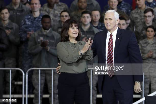 US Vice President Mike Pence right looks on as Second Lady Karen Pence applauds at US Yokota Air Base in Fussa Tokyo Metropolis Japan on Thursday Feb...