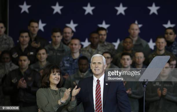 US Vice President Mike Pence right smiles as Second Lady Karen Pence applauds during his speech to US military personnel at Yokota Air Base in Fussa...