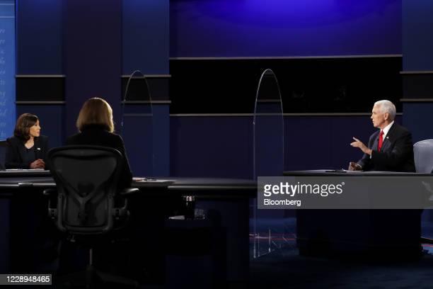 Vice President Mike Pence, right, speaks as Senator Kamala Harris, Democratic vice presidential nominee, left, listens during the U.S. Vice...