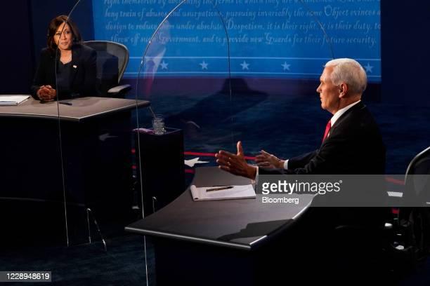 Vice President Mike Pence, right, speaks as Senator Kamala Harris, Democratic vice presidential nominee, listens during the U.S. Vice presidential...