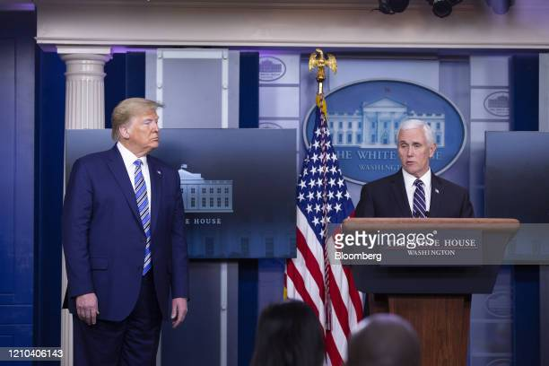 US Vice President Mike Pence right speaks as US President Donald Trump listens during a news conference at the White House in Washington DC US on...