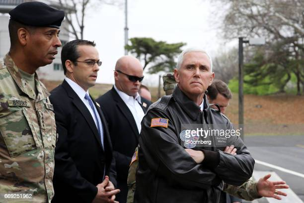 US Vice President Mike Pence right visits to the truce village of Panmunjom in the Demilitarized Zone in Paju South Korea on Monday April 17 2017...