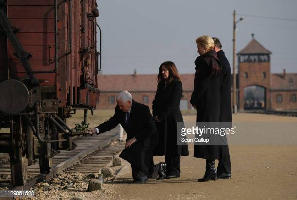Vice President Mike Pence , Second Lady Karen Pence, Polish President Andrzej Duda and Polish First Lady Agata Kornhauser-Duda lay flowers at a...