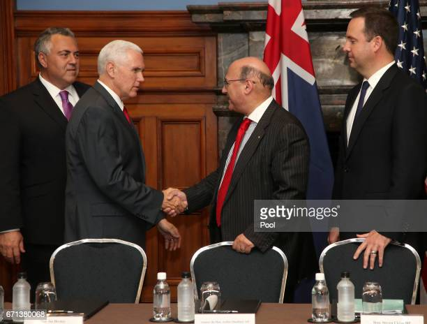 S Vice President Mike Pence second left meets Australian Minister for Industry Arthur Sinodinos Australian Minister for Trade Steven Ciobo right as...