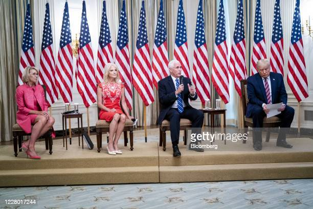 Vice President Mike Pence second right speaks while Betsy DeVos US secretary of education from left Kellyanne Conway senior advisor to President...