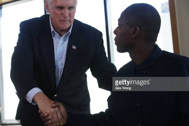 S Vice President Mike Pence shakes hands with Army veteran David Mathis at the USO Warrior and Family Center November 22 2017 in Bethesda Maryland...